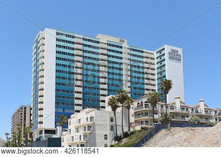LONG BEACH, CALIFORNIA - 5 JULY 2021: 1900 Ocean Beach Club apartments overlooking the Pacific Ocean.