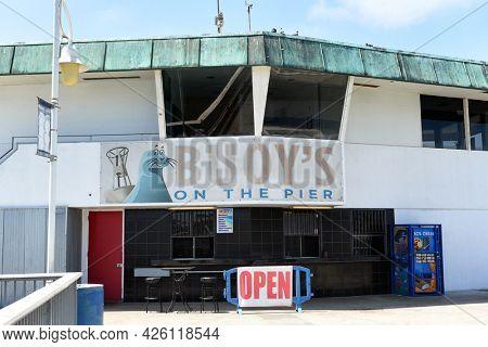 LONG BEACH, CALIFORNIA - 5 JULY 2021: Buoys Restaurant on the Belmont Veterans Memorial Pier.