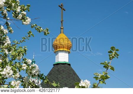 Blooming Branches Of An Apple Tree Against The Blue Sky And The Church Dome.