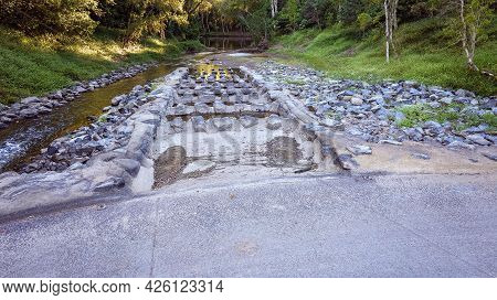 Causeway Built To Improve Fish Migration Into A Creek, Seasonally Dry With Little Water At Present.
