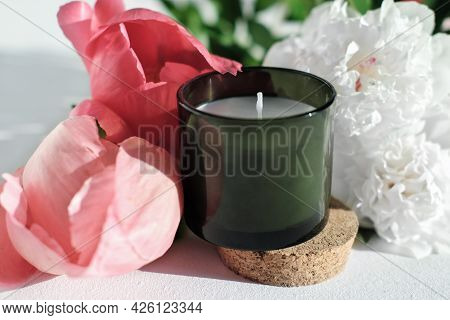 Green Scented Candle And Peony Flowers. Home Fragrances For Relaxation And Calm. Flower Fragrance Fo