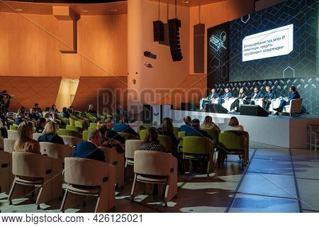Skolkovo, Russia - April 26, 2021: Business conference participants listening to speakers during financial lecture in spacious modern auditorium
