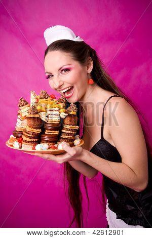 smiling girl holding cake