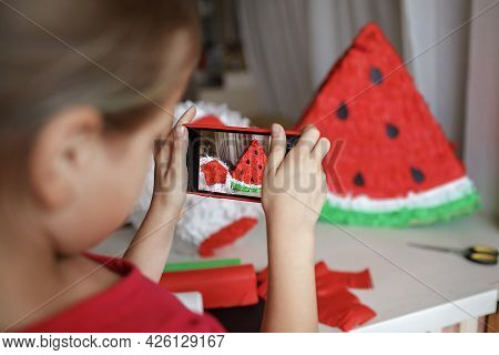 Preteen Girl Making Selfie Of Diy Pinata With Cardboard And Color Crepe Paper To Share It In Social