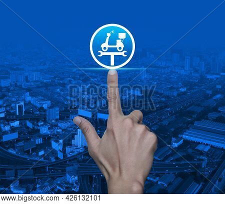 Hand Pressing Service Fix Motorcycle With Wrench Tool Flat Icon Over Modern City Tower, Street, Expr