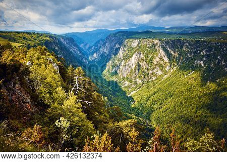 Green valley nature landscape. Mountain layers landscape. Springtime in mountain landscape. River and mountains landscape. Blue mountains layers landscape. Beauty in nature. Landscape. Mountains. Valley nature.