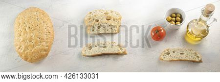Banner With Bread. Focaccia With Herbs, Sliced Focaccia, A Slice Of Bread With Olives, Tomato And Ol