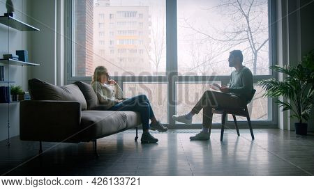 Doctor and patient on therapy against the background of a window indoors
