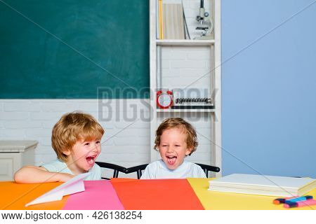 Funny Toddlers From Elementary School Laughing And Smiling. Kids Funny Education. Preschool Children