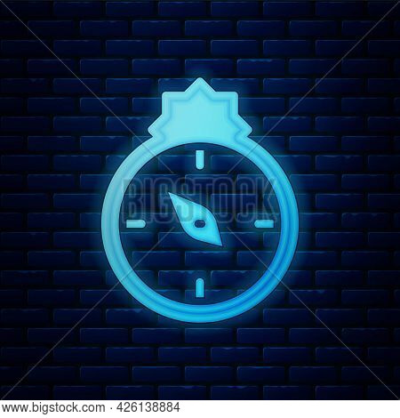 Glowing Neon Qibla Icon Isolated On Brick Wall Background. Qibla Islamic Arab Term Used For The Dire