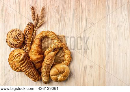 Composition With Bakery Products On Wooden Background, Copy Space