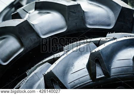 Black Tyre Stack Of Vehicle Or Agricultural And Industrial Machine. Texture Background
