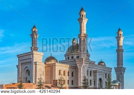 A Muslim Islamic Mosque With Golden Minarets And A Crescent Moon Against The Sky.a Religious Temple