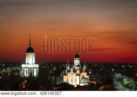 A Church,temple Or Cathedral Against The Background Of An Evening Sunset With A Maroon Sky And A Big