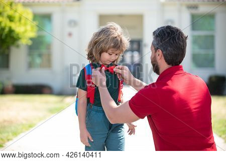 Parent Taking Child To Primary School. Smart Child. Adorable School Nerd. Intellectual Kid Wear Bow