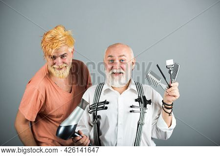 Hairdresser With Male Client. Hairstylist Serving Client At Barber Shop. Barber With Scissors And Ra