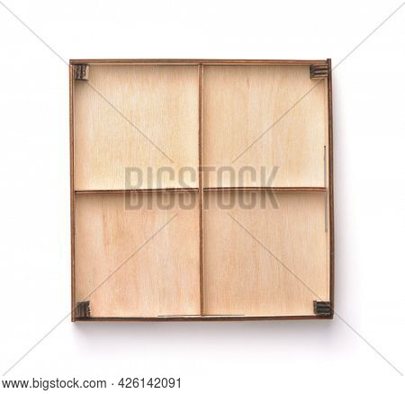 Top view of empty wooden four compartments packaging tray isolated on white