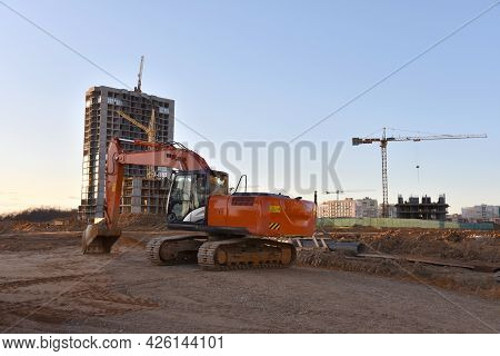 Excavator On Earthworks At Construction Site. Heavy Machinery And Equipment For Earthmoving