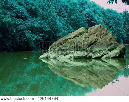 Extreme Big Stone Rock Water Reflection Image Presented At River Nature Shot.