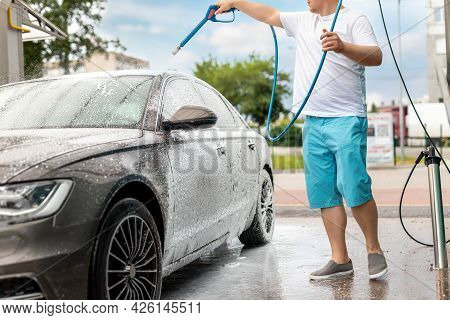 Close-up Detail Car Wash With High Pressure Water Equipment Pump At Self-service Outdoor On Bright S