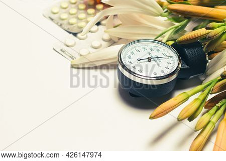 Sphygmomanometer For Measuring Blood Pressure And Pills. Hypertension Day, Photo For Cardiology And