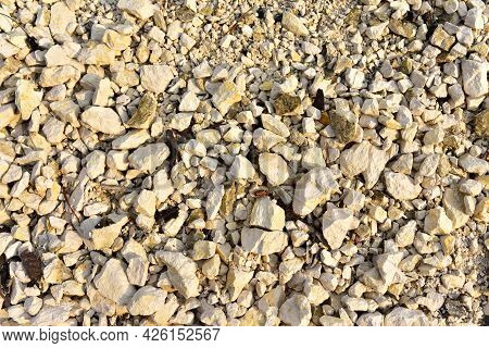Natural Chalk Stones Background. Chalk Is A Soft, White, Porous, Sedimentary Carbonate Rock, A Form