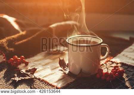 Autumn Hot Steaming Cup Of Coffee Or Tea.