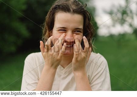 Close-up Portrait Of Teenager Girl. Cheerful Teen Girl With Pronounced Face From Sprayed Small Splas