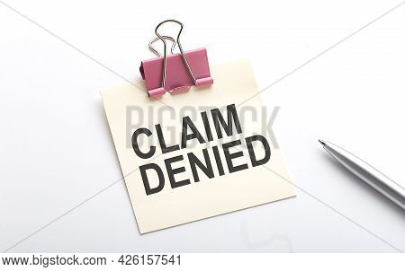 Claim Denied Text On Sticker With Pen On White Background