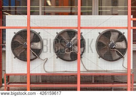 Selective Focus Of Large Ventilation System Fans In A Public Building. Metal Industrial Air Conditio