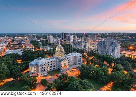 Jackson, Mississippi, USA skyline over the Capitol Building at dusk.