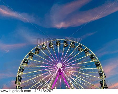 High Ferris Wheel On A Sunset Backdrop In Our Summer Vacation. Amusement Park Ride. Adriatic Coast I