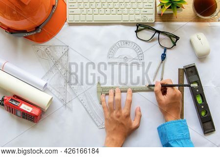 Top View Architect Working On Blueprint. Architects Workplace. Engineer Tools And Safety Control, Bl