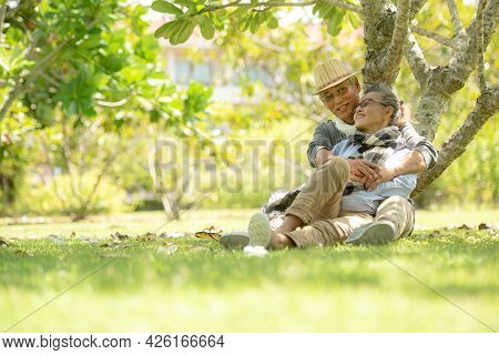 Asian Senior Elderly Retire Couple Relaxation In The Nature Park Happy And Relax Time.  People Old A