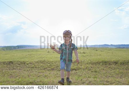 Start Traveling From Childhood Even In Imagination. Child Playing Pilot Aviator In Grass Field