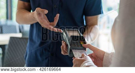 Hand Of Customer Paying With Contactless Credit Card With Nfc Technology. Bartender With A Credit Ca