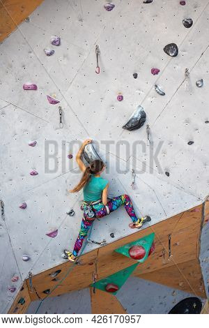 Rock Climber Climbs The Route. Climbing Wall In The City For Extreme Sports.