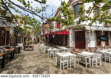 Ayvalik, Turkey: Small Bars And Cafe With Terraces, Tables In Turkish Town On 27 April, 2021. Ayvali