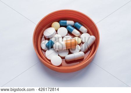 Tablets And Pills Are On The Lid Of The Test Jar, Consuming A Lot Of Pills Concept