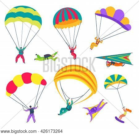 Skydivers. People With Parachutes Flying In Sky. Professional Paragliders, Skydivers In Wingsuits. E