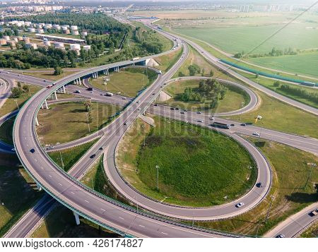 Aerial View Highway Interchange Multiple Road Interchanges. Traffic Cars Driving On A Motorway