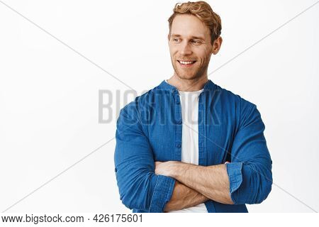 Close Up Of Handsome Confident Guy With Red Hair And Bristle, Cross Strong Arms Over Chest, Smiling