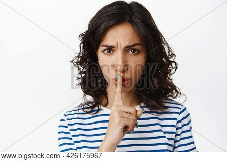 Close Up Of Woman Shushing With Angry Face, Scolding Tell To Keep Quiet, Hush Gesture, Frowning With