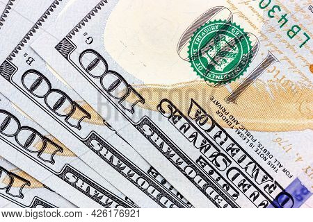 Background Image Of One Hundred Dollar Bills. Several Hundred Dollar Bills.