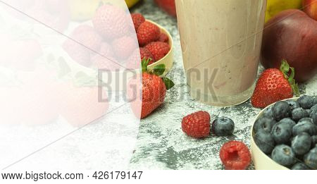 A Cold Milkshake With Fresh And Delicious Fruits. Fresh Blueberry And Strawberry Smoothies. Backgrou