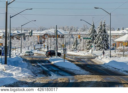 Trees And Streets Of Canadian Town After A Freezing Rain Storm
