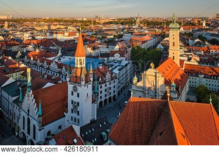 Aerial view of Munich - Marienplatz and Altes Rathaus from St. Peter's church on sunset. Munich, Germany