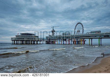 The Scheveningen Pier Strandweg, beach resort on North sea in The Hague Den Haag with Ferris wheel. The Hague, Netherlands