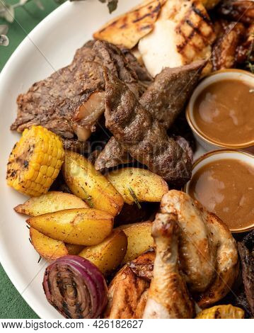 Grilled Assorted Meat And Vegetables. Close-up Shot Of Platter With Tasty Lunch. Vertical Format. So