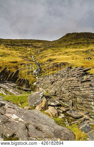 Hillside With Stream And Old Slate Wall.